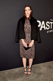 Mandy Moore finished off her conservative outfit with a black swing jacket, also by Prada.