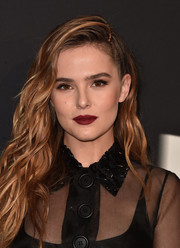 Zoey Deutch looked fabulous with her bold red lip.