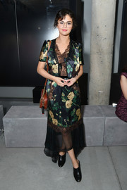 Selena Gomez paired her dress with black clogs by Tod's.