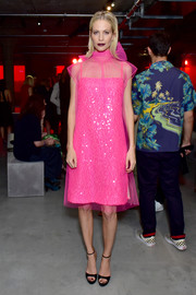 Poppy Delevingne brought a dazzling pop of color to the Prada Resort 2019 show with this hot-pink sequin and chiffon dress from the label.