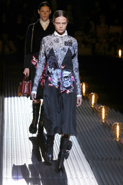 Cara Delevingne sported a Frankenstein-print dress at the Prada runway show.