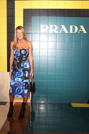 Anna dello Russo attended the Prada Spring 2020 show wearing a strapless floral midi dress from the label.
