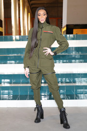 Winnie Harlow completed her edgy look with black combat boots, also by Prada.