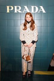 Sadie Sink attended the Prada Spring 2020 show wearing a printed pantsuit from the brand.