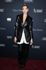 Dua Lipa showed off her unique style with this monochrome faux-leather suit by Peter Do at the 2020 pre-Grammy gala.