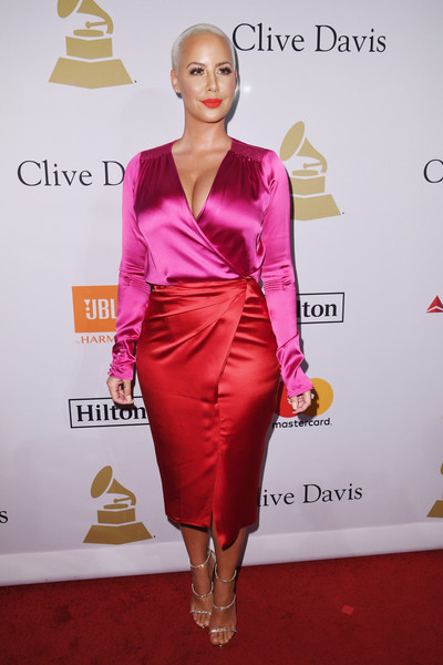 Amber Rose finished off her chic ensemble with silver triple-strap sandals.