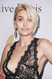 Paris Jackson attended the pre-Grammy gala wearing her hair in a bun with emo bangs.