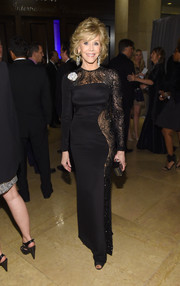The eternally sexy Jane Fonda showed off her amazing figure at the pre-Grammy gala in a tight black Emilio Pucci gown with sheer lace detailing running down one side.