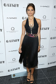 Shanina Shaik channeled retro flapper girls with this halter LBD that featured a fringed skirt and a colorful belt.