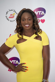 Sloane Stephens' bright orange nail polish provided a nice color contrast to her yellow dress at the pre-Wimbledon party.