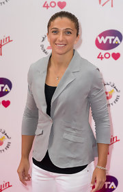 Sara Errani went for a neutral menswear-inspired look with a gray blazer, a black top, and white pants at the pre-Wimbledon party.