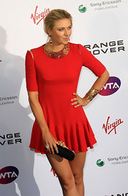 Maria Sharapova completed her Alexander McQueen mini dress with a satin box clutch with gold hardware at the top.