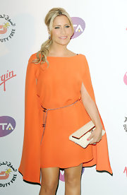 Heidi Range styled her look with Chanel accessories including a chain rope belt at the Pre-Wimbledon Party.