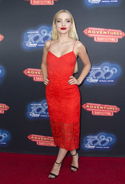 Dove Cameron opted for simple black ankle-strap heels to finish off her look.