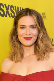 Mandy Moore swiped on some red lipstick to match her outfit.