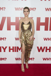 Zoey Deutch amped up the shine with gold fishnet pumps by Christian Louboutin.