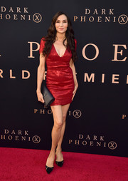 Famke Janssen looked ageless in a red sequined mini dress at the premiere of 'Dark Phoenix.'
