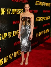 Gal Gadot finished off her high-shine ensemble with silver sandals by Stuart Weitzman.