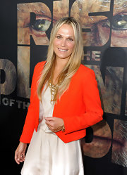 Molly Sims donned a bright jacket paired with glowing skin and sleek straight locks.