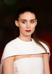 Rooney Mara pulled her hair back in a stark half-up 'do for the premiere of 'Her' in Rome.