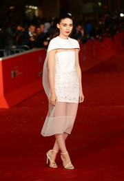 Rooney Mara attended the 'Her' premiere in Rome wearing a caped white cocktail dress by Balenciaga.