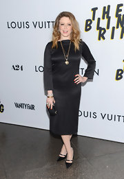 Natasha Lyonne looked super classic in a long-sleeve black satin dress.