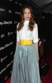 Michelle Monaghan teamed an oversized yellow belt with a blue skirt and a white button-down, all by Carolina Herrera, for the premiere of 'The Vanishing of Sidney Hall.'