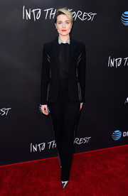 Evan Rachel Wood kept it understated in a black pantsuit with white trim at the premiere of 'Into the Forest.'