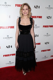 Brie Larson cut an ultra-feminine figure in a black lace-panel, fit-and-flare gown by Elie Saab at the premiere of 'Free Fire.'