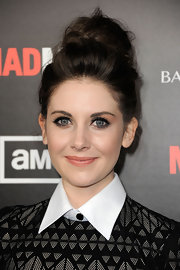 Alison Brie perfected her pout with a pretty pastel peach lipstick for the fifth season premiere of 'Mad Men.'