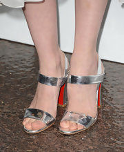 January Jones stuck to a minimalistic look with these silver evening sandals.