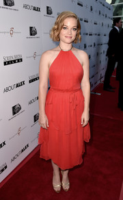 Jane Levy oozed ultra-feminine appeal in a red halter dress by Reem Acra at the premiere of 'About Alex.'