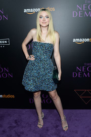 Dakota Fanning captivated in a Monique Lhuillier strapless dress, rendered in blue and black sequins, during the 'Neon Demon' premiere.