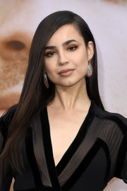 Sofia Carson wore her hair long and straight with a side part at the premiere of 'Chasing Happiness.'