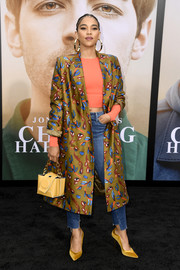 Alexandra Shipp teamed a printed coat with a crop-top and jeans for the premiere of 'Chasing Happiness.'
