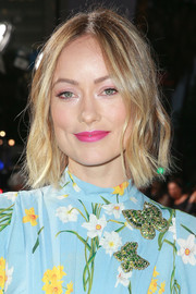 Olivia Wilde's pink lipstick worked beautifully with her blue dress.
