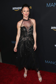 Juliette Lewis made a chic appearance at the premiere of 'Manchester by the Sea' wearing an embellished sheer-panel halter dress.