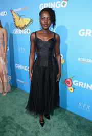 Lupita Nyong'o went bondage-glam in a black corset dress by Dolce & Gabbana at the premiere of 'Gringo.'