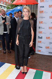 Laura Ramsey teamed black pointy pumps with cigarette pants and a dramatic cape blouse for the premiere of 'You are Here.'