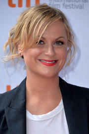 Amy Poehler attended the premiere of 'You are Here' wearing a messy-chic updo.