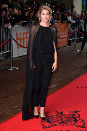 Laura Ramsey looked so sophisticated in black cigarette pants and a matching caped blouse during the premiere of 'You are Here.'