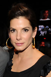 Sandra Bullock wore statement gold hoop earrings with her dark ensemble at 'The Blind Side' premiere.