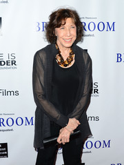 Lily Tomlin layered a sheer black blazer over her tank and slacks combo for a chicer finish at the 'Bridegroom' premiere.