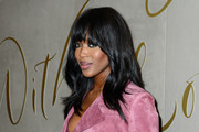 Naomi Campbell styled her hair with subtle waves and rounded bangs for the Burberry festive film premiere.