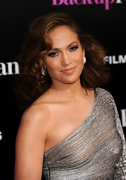 Jennifer glowed in a one-shouldered metallic dress with a glamorous curled hairstyle.