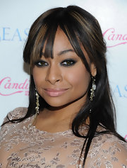 Raven-Symone added a dash of sultry sizzle with smoky shadow rimmed around her eye.