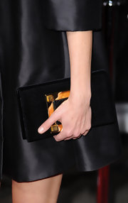 Keri Russell carried an ultra-elegant embellished black satin clutch at the premiere of 'Extraordinary Measures.'