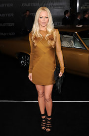 Charlotte looks fantastic in a bronze chiffon cocktail dress at the 'Faster' premiere.