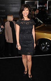 Julie Chen goes for lovely lace in this little black cocktail dress at the 'Faster' premiere.