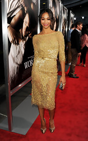 Zoe Saldana's gold pointy-toe pumps with an ankle strap were just the trendy finishing touch for her shimmering ensemble.